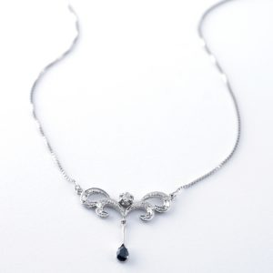 classical design necklace with a sapphire and diamonds